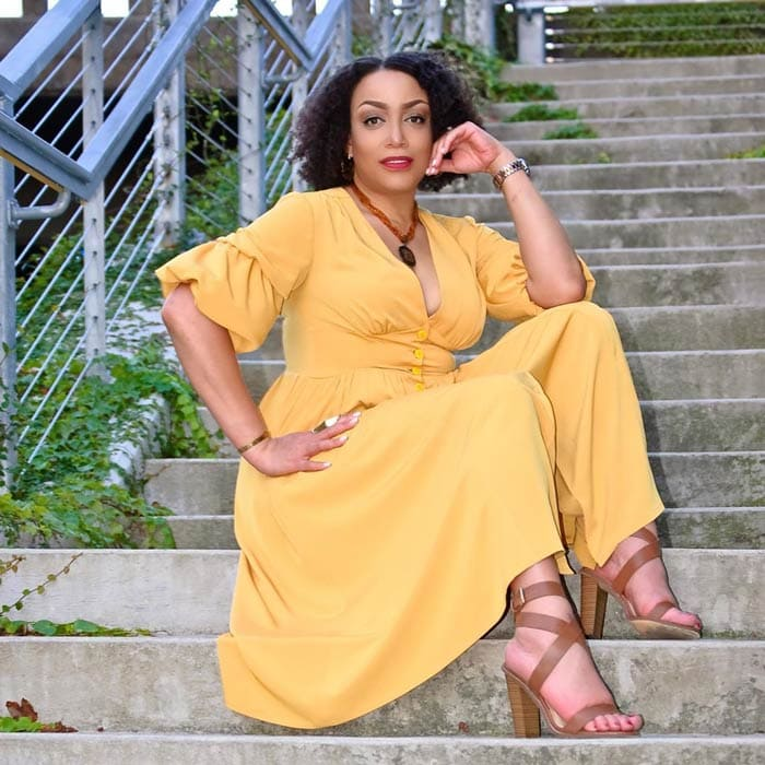 Blogger and influencer Erica wears a yellow dress with sandals   40plusstyle.com