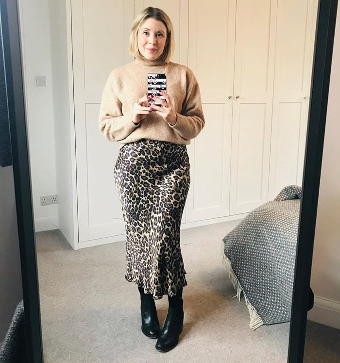 a beige sweater with an animal print skirt | 40plusstyle.com