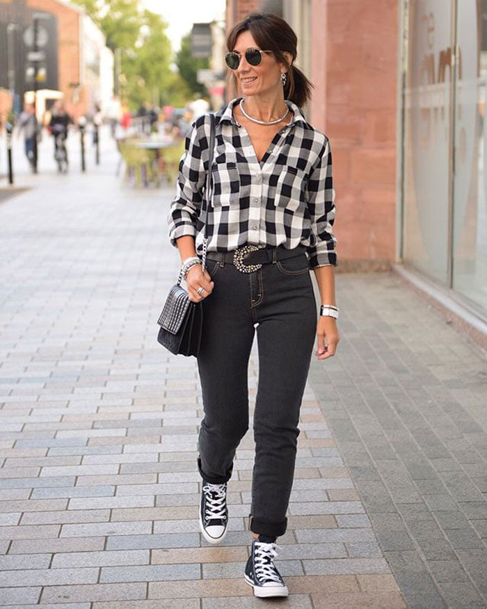 Patricia wearing a check shirt, jeans and sneakers | 40plusstyle.com