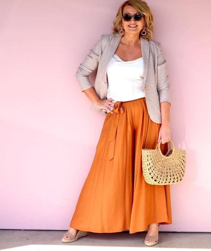 wear an orange skirt with a beige jacket | 40plusstyle.com