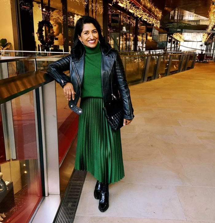 green pleated skirt and moto jacket | 40plusstyle.com