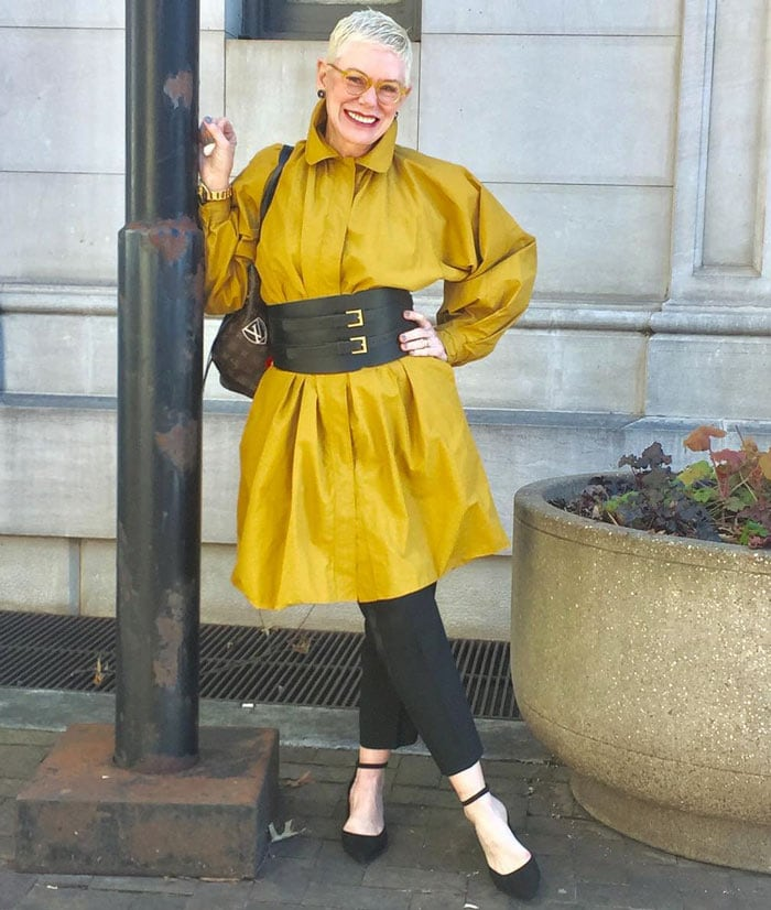 wearing a yellow shirt dress belted over pants | 40plusstyle.com