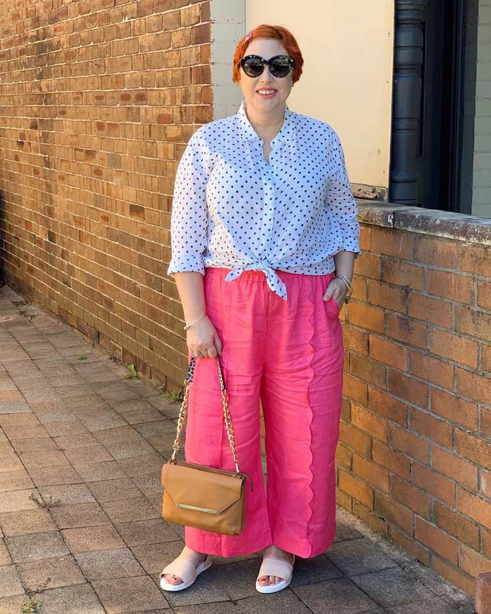 wearing a bright pair of elastic waist pants with a polka dot blouse | 40plusstyle.com