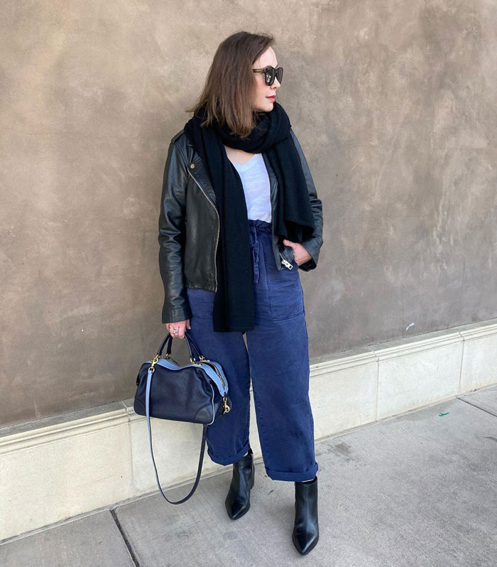 wearing a moto jacket with cropped pants | 40plusstyle.com