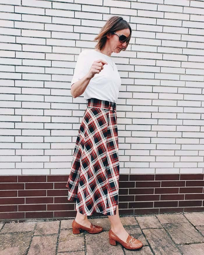 a white tee and check skirt outfit | 40plusstyle.com