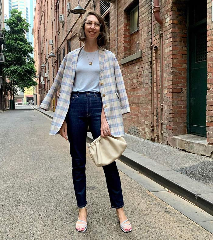wearing a checked jacket with jeans and sandals | 40plusstyle.com