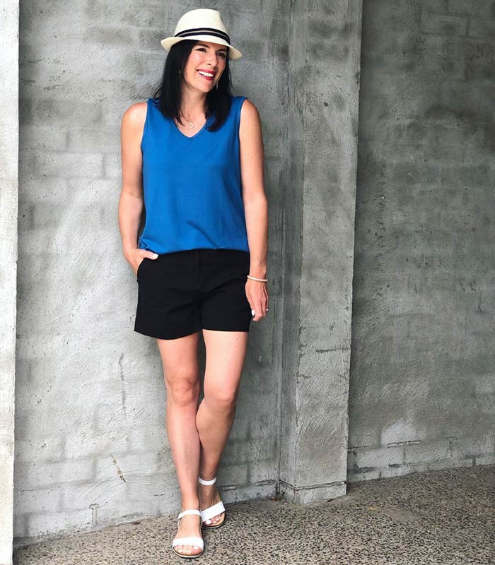black shorts with a cobalt blue top | 40plusstyle.com