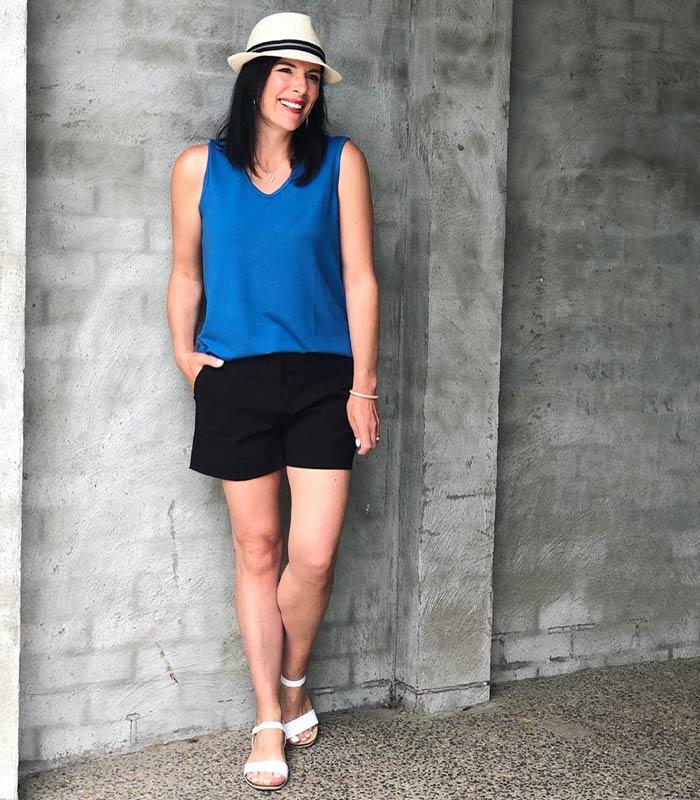 black shorts with a cobalt blue top | 40plusstyle.com