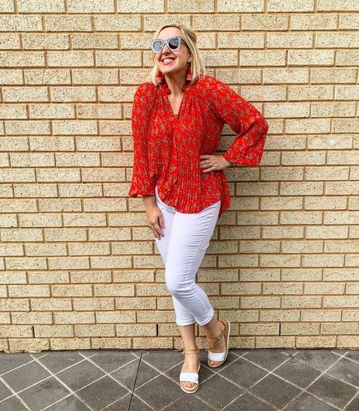 white jeans and a red blouse | 40plusstyle.com