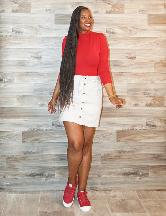 wearing red sneakers with a skirt | 40plusstyle.com