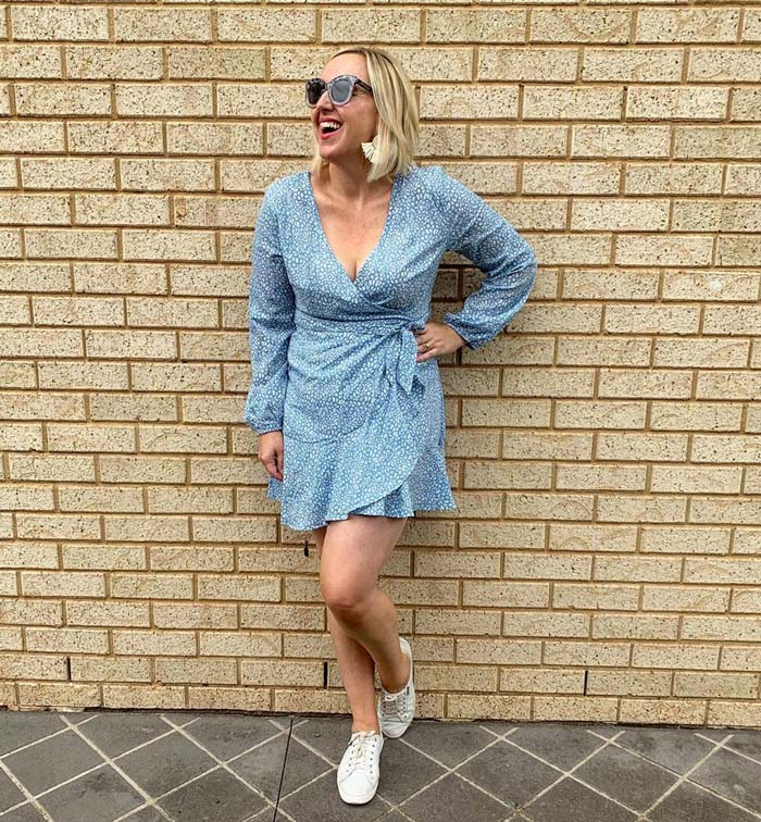 wearing a mini wrap dress with sneakers | 40plusstyle.com