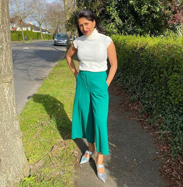 White top with green pants and silver shoes | 40plusstyle.com