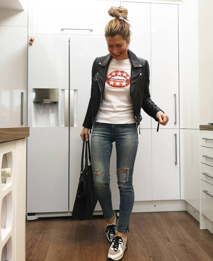 Abi wearing a moto jacket and jeans   40plusstyle.com