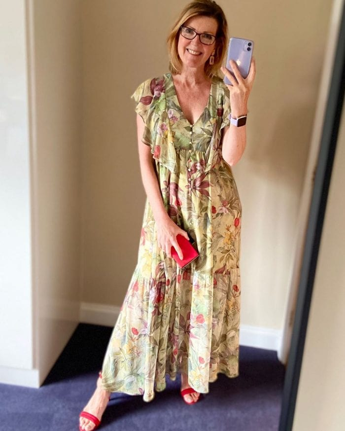 Helen wearing a floral maxi dress with red accessories | 40plusstyle.com