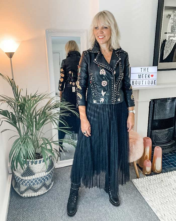 Lynne wearing a rock style moto jacket and black skirt   40plusstyle.com