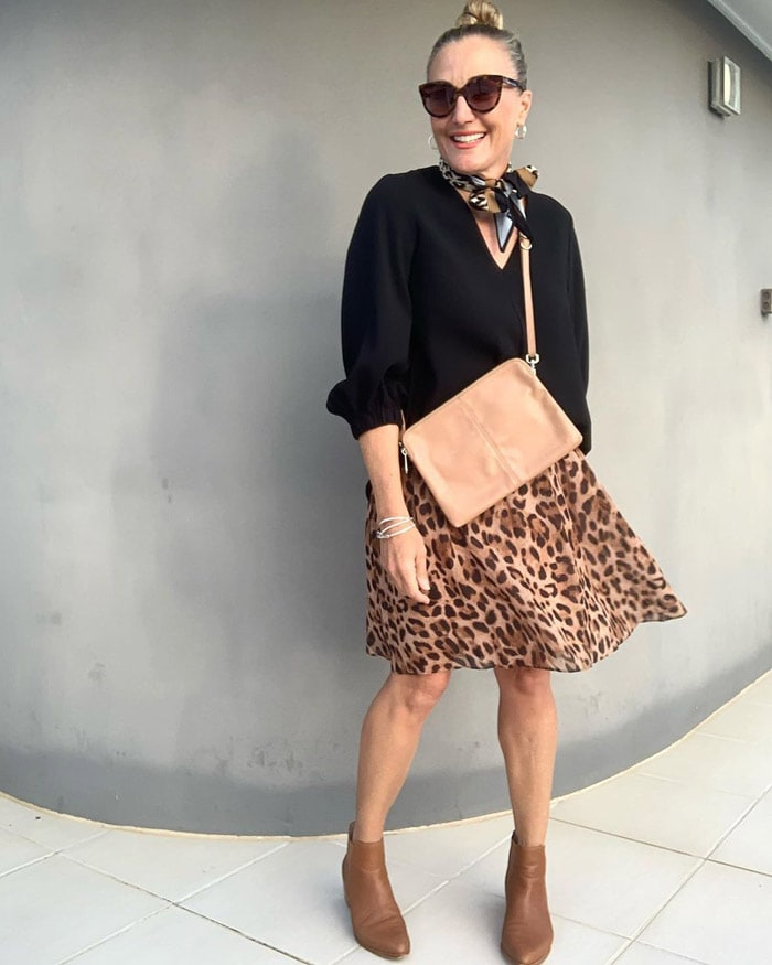 wearing flat booties with animal print | 40plusstyle.com