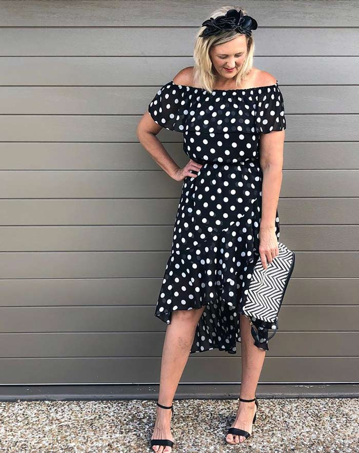 Dresses to wear for the rectangle body shape - Nic wearing a polka dot high/low piece   40plusstyle.com