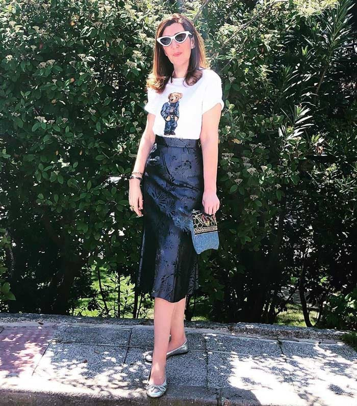 Rocio wearing silver ballet flats and a black skirt | 40plusstyle.com