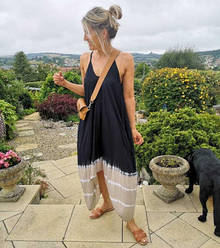 Abi wears a maxi dress and crossbody bag | 40plusstyle.com