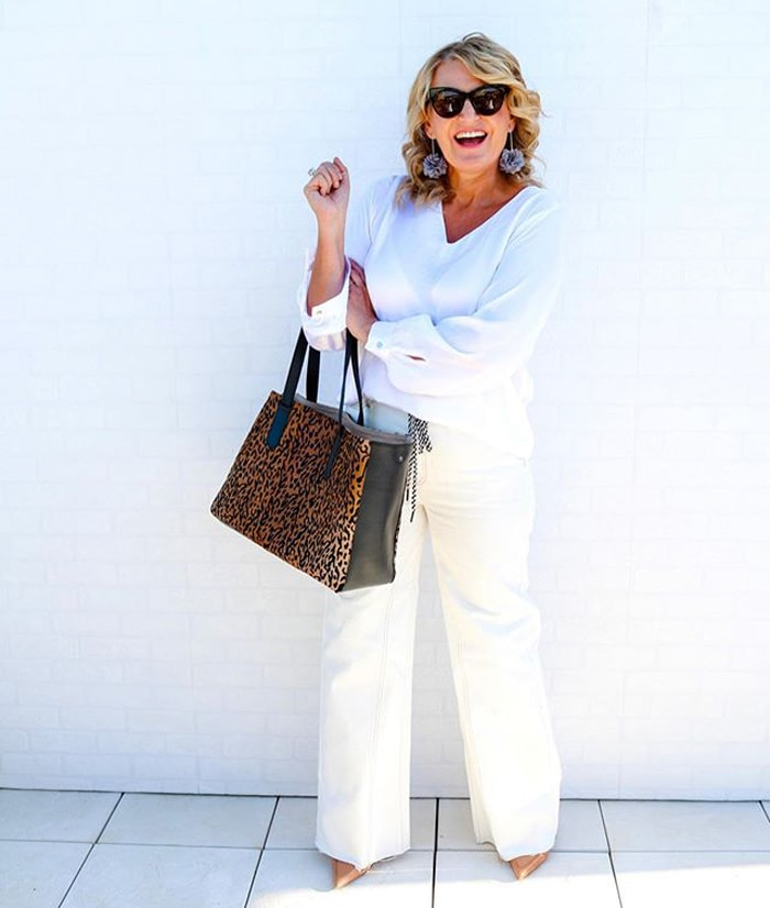 Bev in an all-white outfit with leopard print | 40plusstyle.com