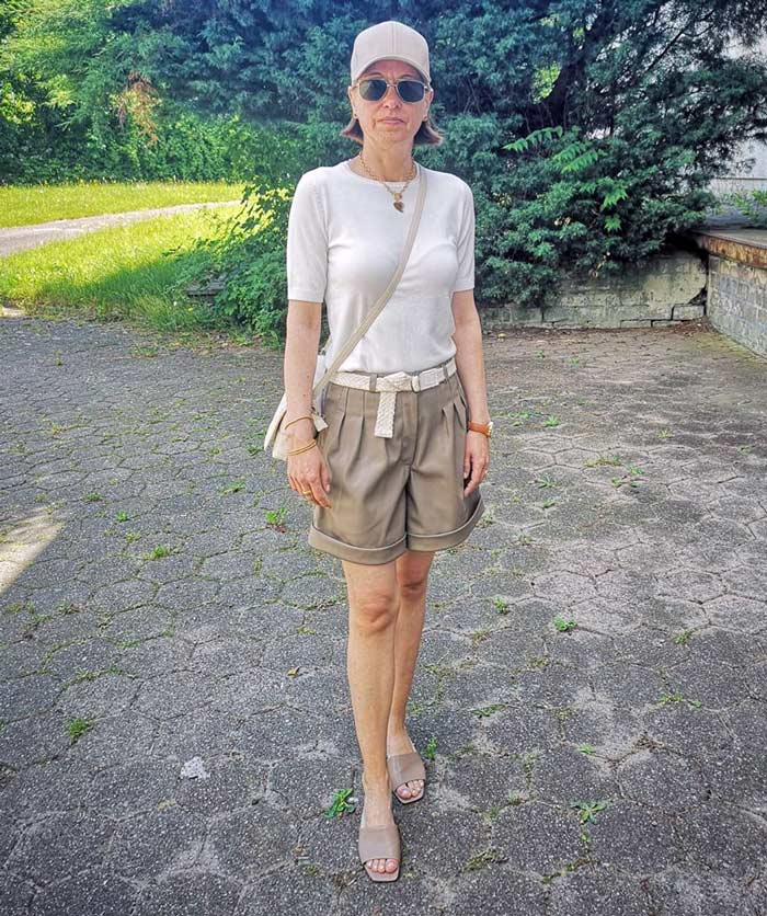 Chris wears her white tee with shorts and neutral accessories | 40plusstyle.com
