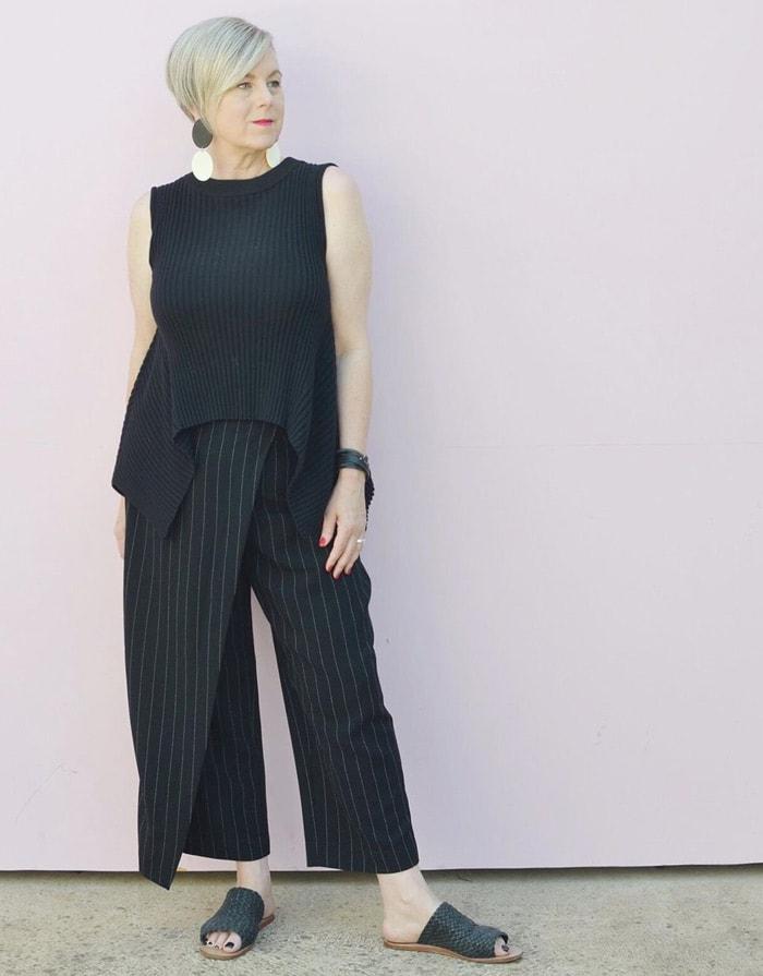 Deborah wearing an asymmetrical top and pants   40plusstyle.com