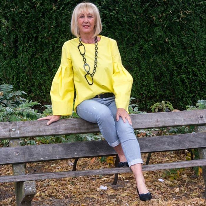 Greetje wears a geometric necklace   40plusstyle.com