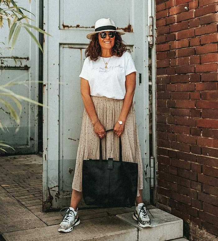 Natalie wearing a logo white tee   40plusstyle.com