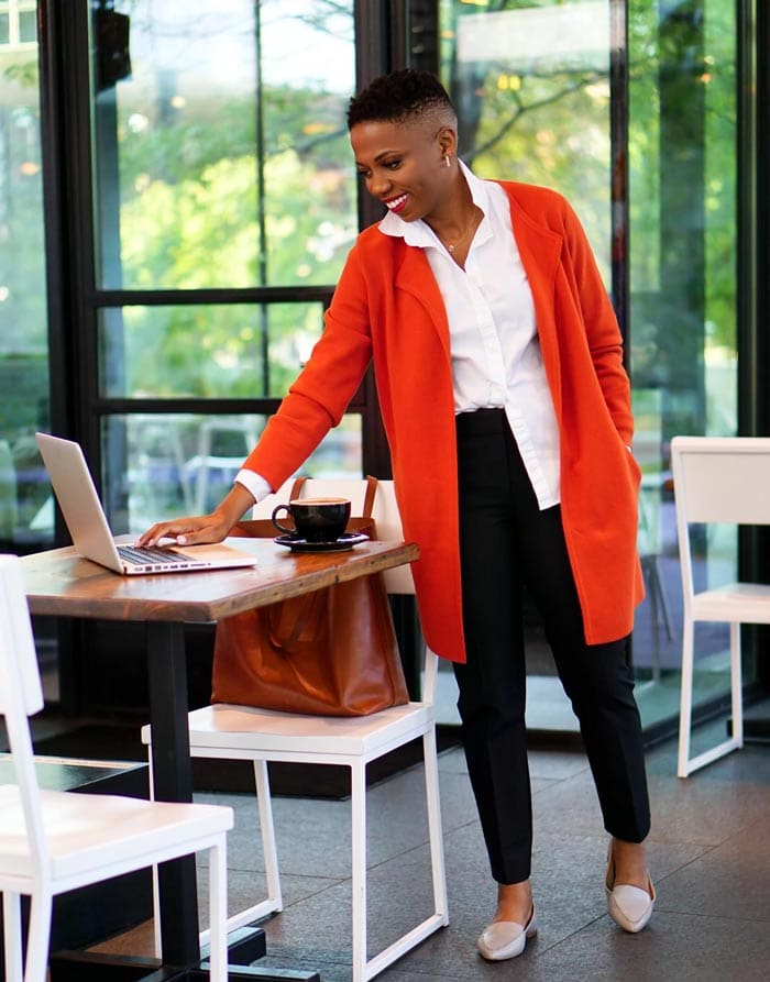 Psyche wears cream loafers with a red cardigan | 40plusstyle.com