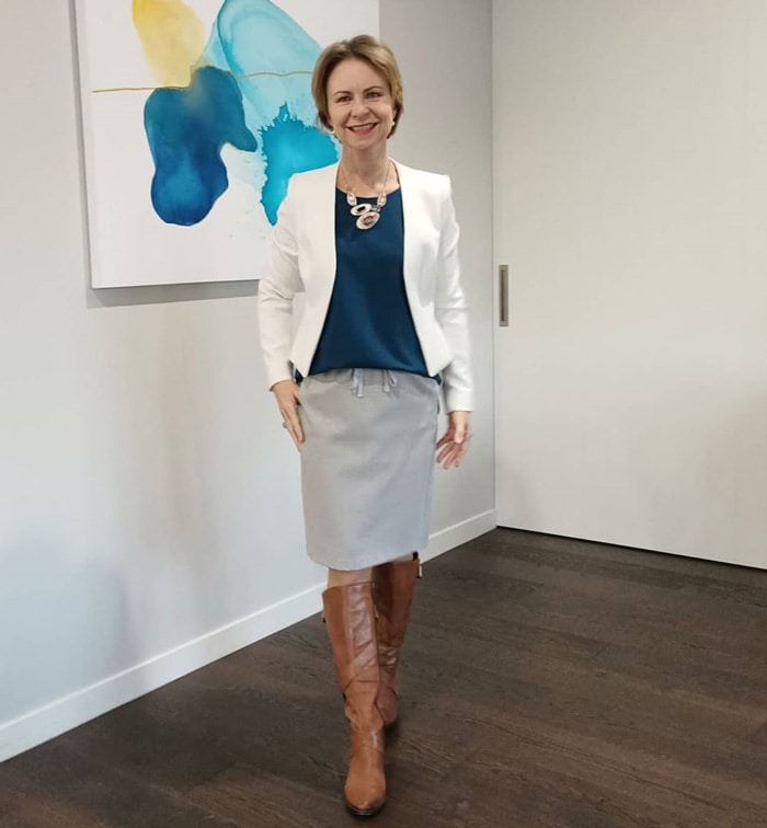 Wearing knee-high boots for work - Rachel wears boots with her pencil skirt | 40plusstyle.com