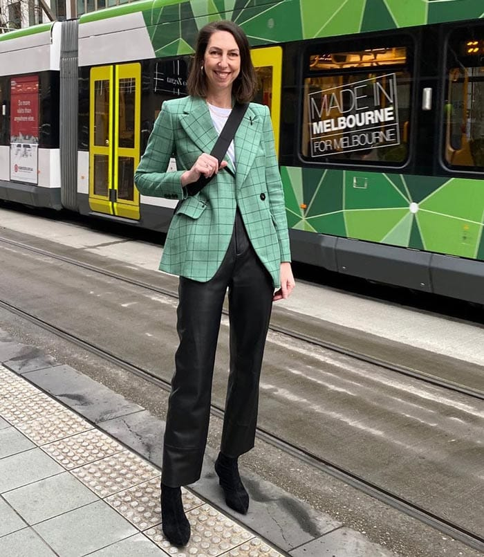 Sally wears a check blazer and leather pants | 40plusstyle.com