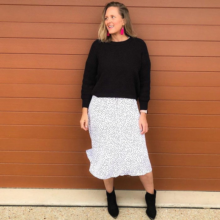 Nic wears a summer skirt with a sweater | 40plusstyle.com