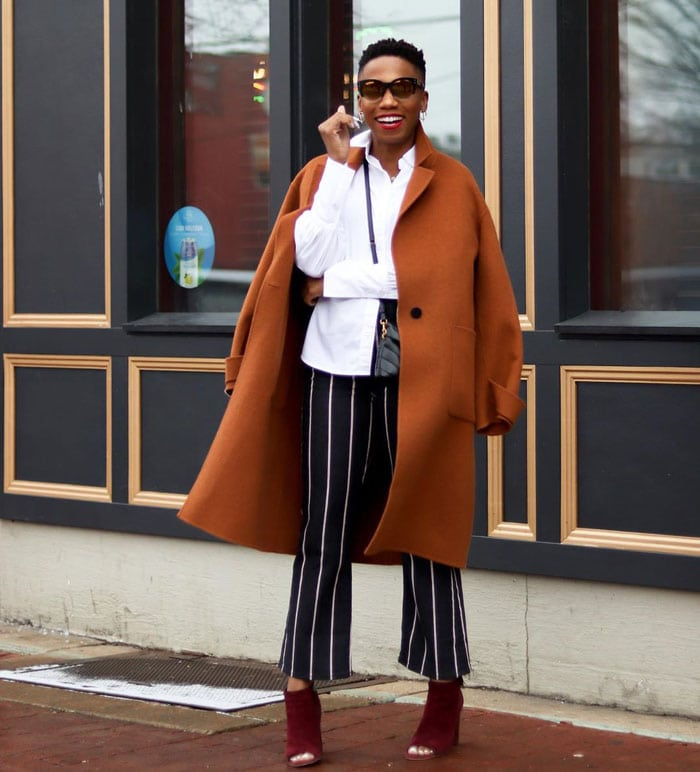 Psyche wears an orange coat and burgundy boots for fall | 40plusstyle.com