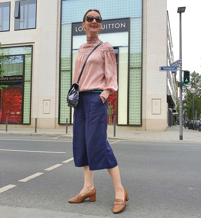 Sabina wears navy with tan accessories | 40plusstyle.com