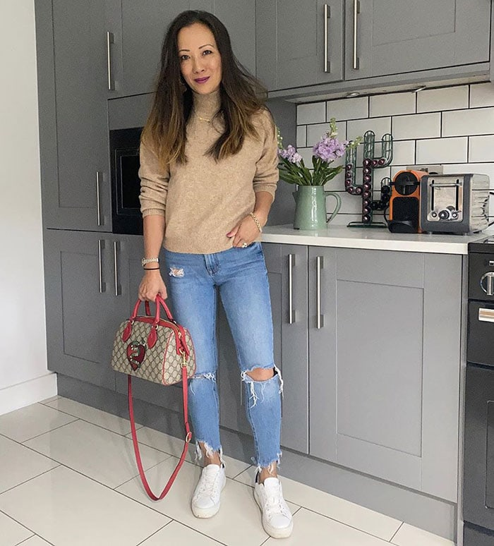 Abi wears a turtleneck with jeans | 40plusstyle.com