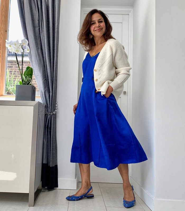 Anita wearing low heel party flats with her matching blue dress   40plusstyle.com