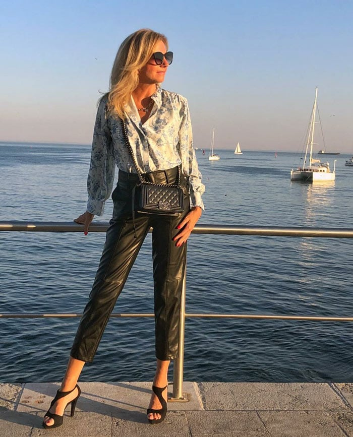 Elke wearing a print blouse and leather pants | 40plusstyle.com