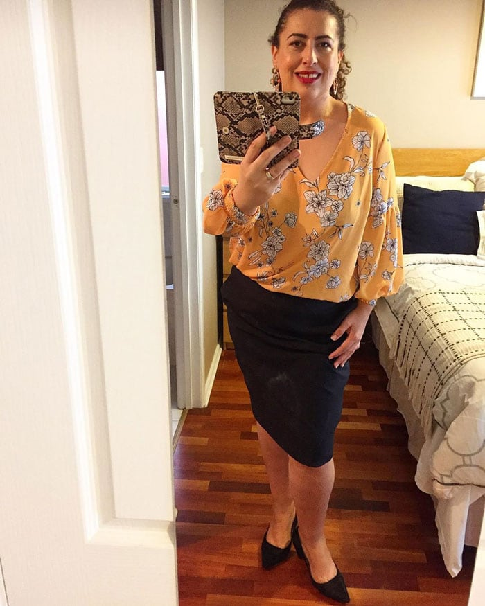 Fee wearing low heel shoes with her pencil skirt and blouse   40plusstyle.com