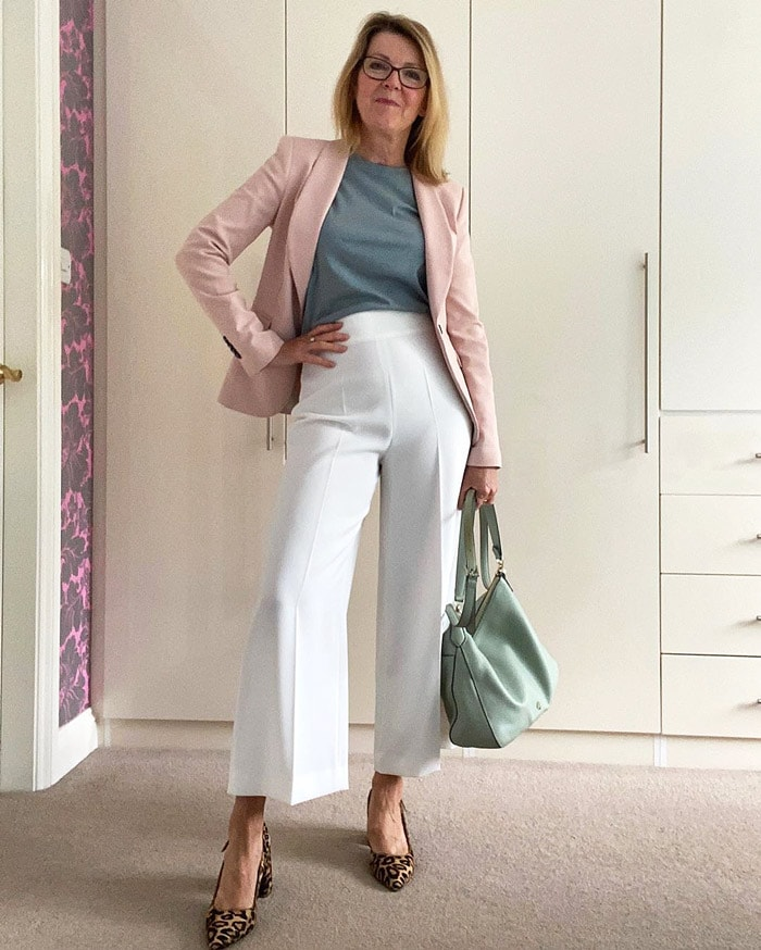Wearing a pair of flared pants for a classic, timeless look   40plusstyle.com
