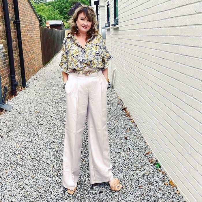 Wear long wide leg pants and heels to create a lengthening effect   40plusstyle.com