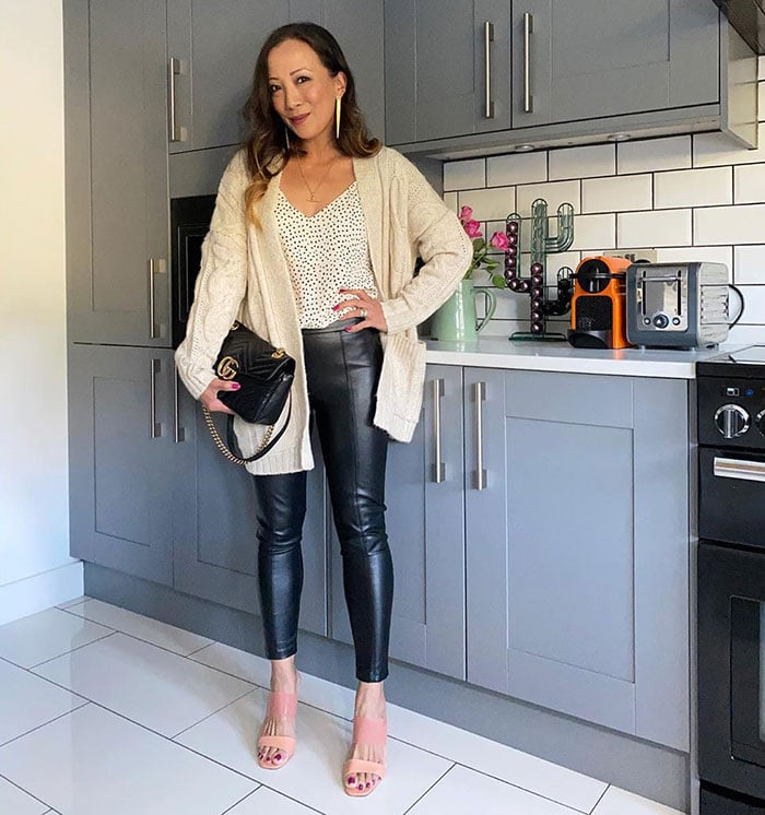 Abi wearing leather pants and a cardigan | 40plusstyle.com