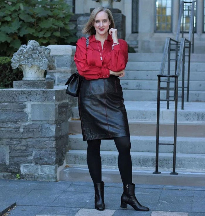 Casual party outfits - Ashley wearing a leather skirt and satin blouse | 40plusstyle.com