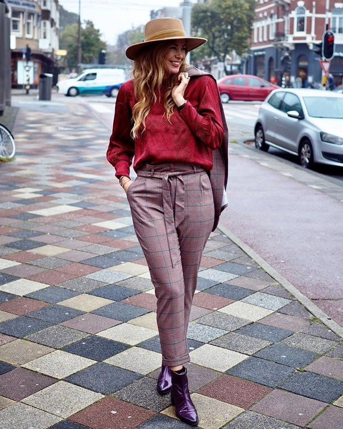 Claudia wearing purple and red | 40plusstyle.com