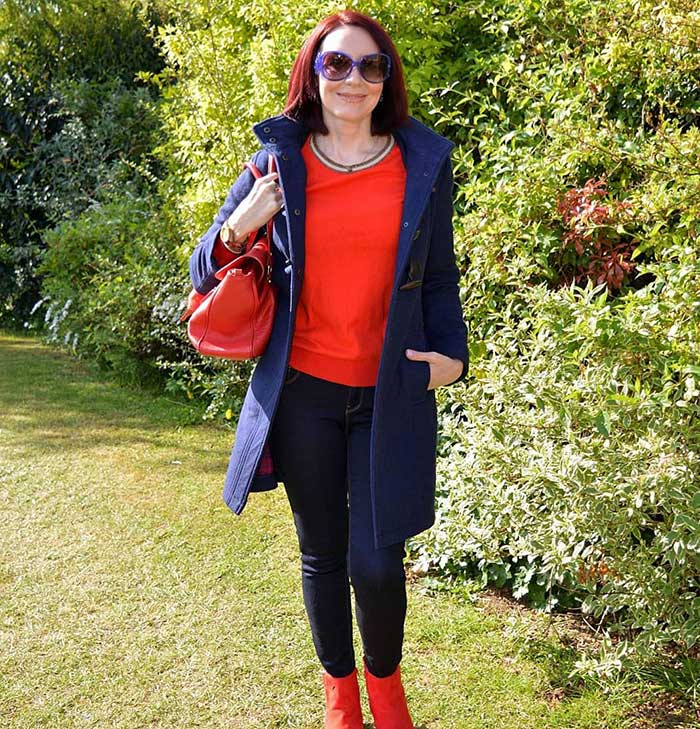 Emma wears a red sweater and booties   40plusstyle.com