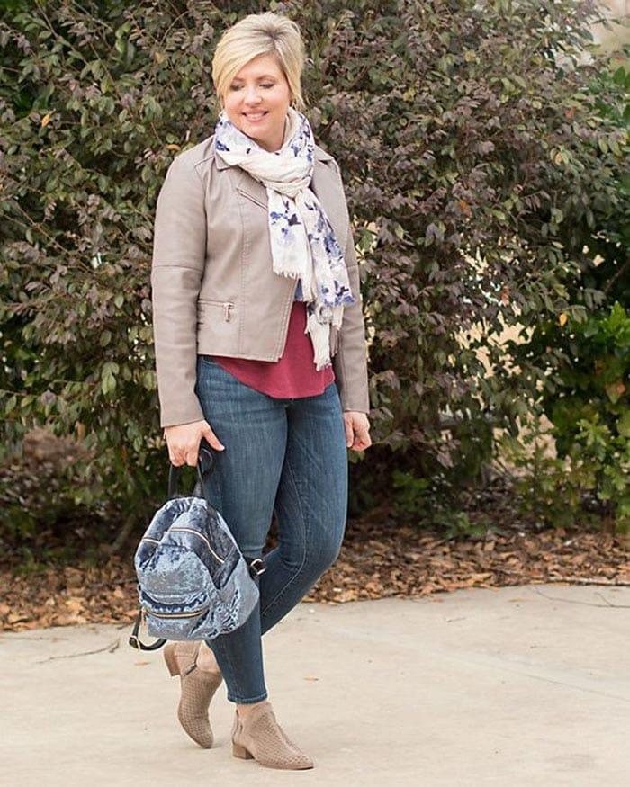 Winter capsule wardrobe - Fonda wears jeans and a moto jacket   40plusstyle.com