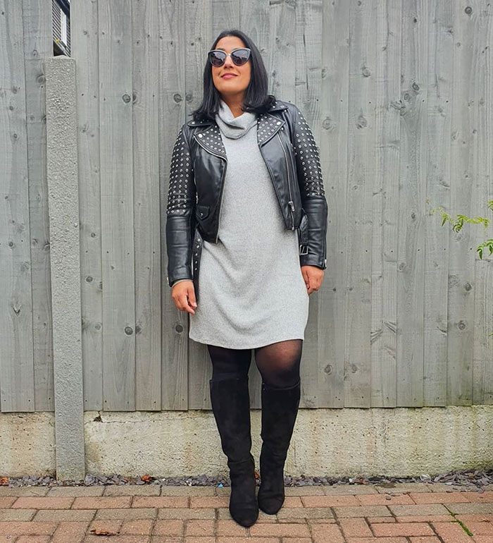 Jas wearing a winter sweater dress with a moto jacket and boots | 40plusstyle.com
