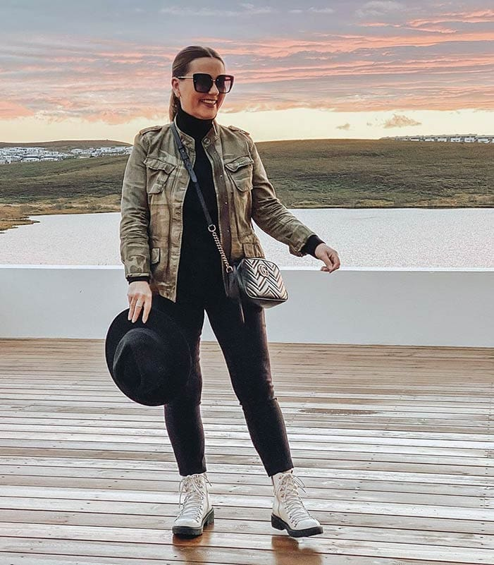 Winter capsule wardrobe - Jona in a utility jacket and lace-up boots   40plusstyle.com