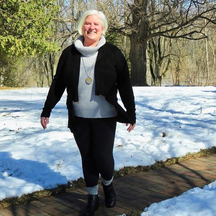 Julia wears leggings with her knitwear | 40plusstyle.com