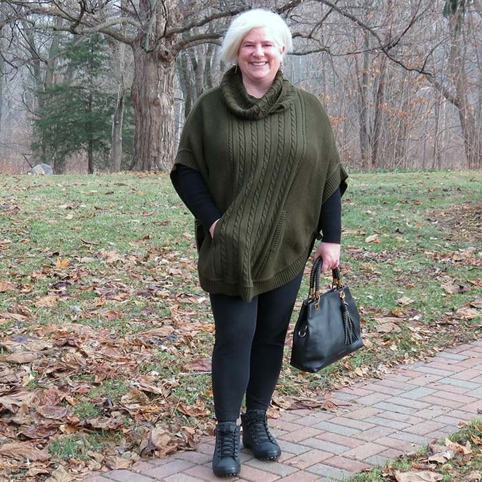 Julia layers her long-sleeved top with a poncho   40plusstyle.com
