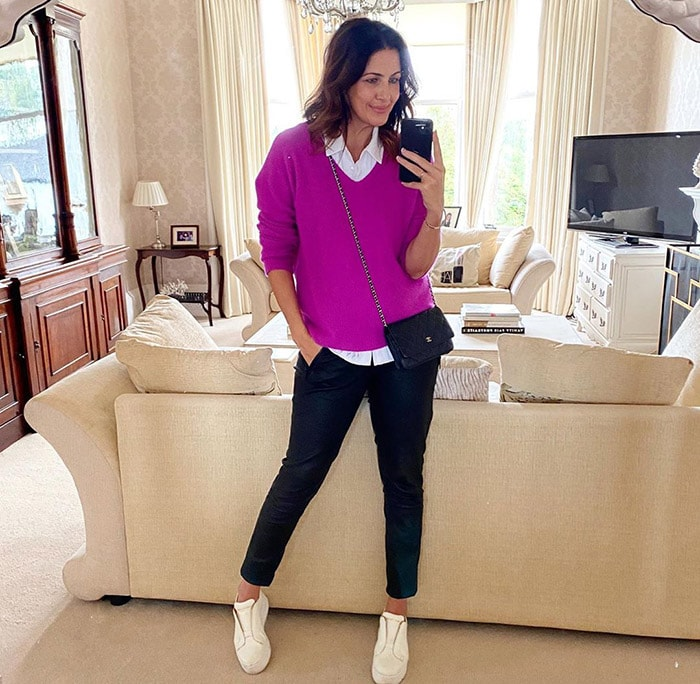 Purple outfits - Julie wears a purple sweater and black pants | 40plusstyle.com